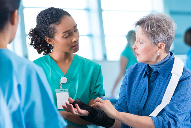 Image of medical professional speaking with a patient